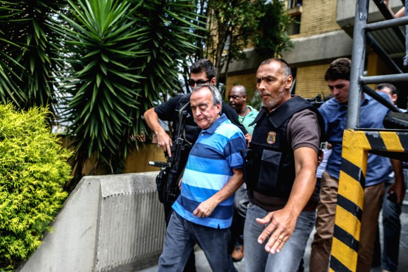Security elements escort the former international director of the Brazil's state-run oil company Petrobras Nestor Cervero (L), after being arrested in .