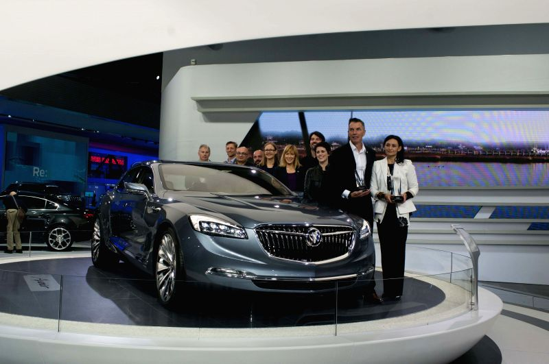 The design team of Buick pose for group photo with Buick Avenir Concept in Detroit, the united States. on Jan. 13, 2015. EyesOn Design Awards 2015 was ...