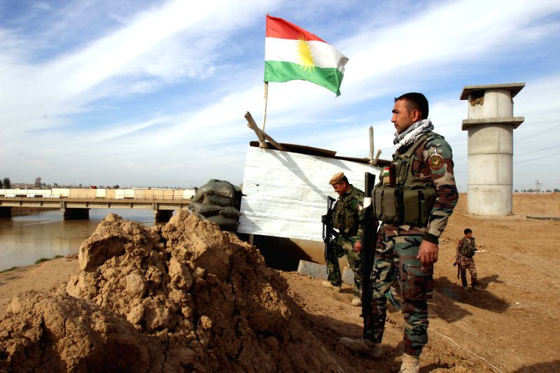 A soldier of Kurdish Peshmerga forces looks far into the area controlled by Islamic State militants in the Khalid's Office, an area 25 km west of Kirkuk,