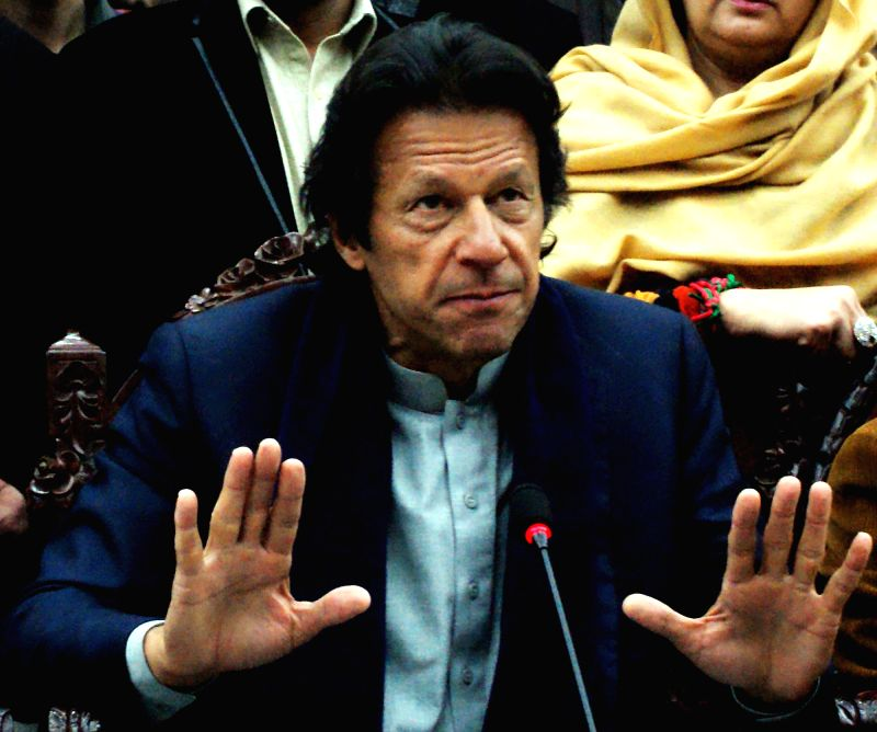 Pakistan Tehreek-e-Insaf chief Imran Khan addresses a press conference in northwest Pakistan's Peshawar on Jan. 14, 2015. Pakistan Tehreek-e-Insaf ... - Reham Khan
