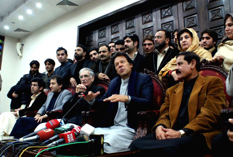 Pakistan Tehreek-e-Insaf chief Imran Khan (2nd R) addresses a press conference in northwest Pakistan's Peshawar on Jan. 14, 2015. Pakistan ... - Reham Khan