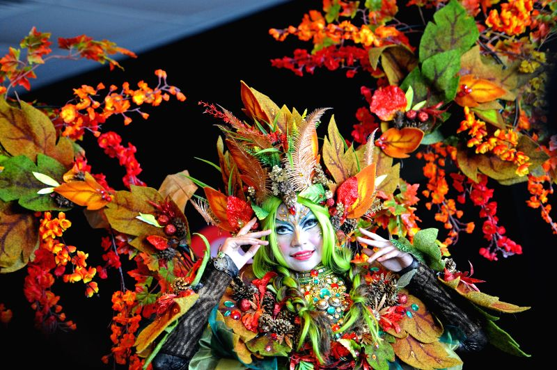 An Indonesian Chingay performer attends a press conference held at Singapore's F1 Pit Building in Marina Bay, Jan. 14, 2015. Organisers of the Chingay