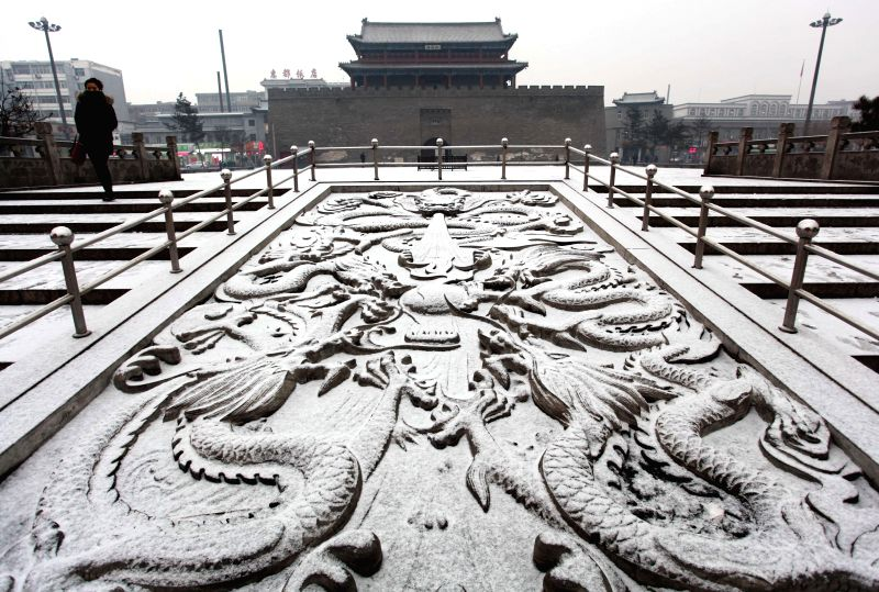 Photo taken on Jan. 14, 2015 shows a snow-covered square in Xuanhua District of Zhangjiakou, north China's Hebei Province. Zhangjiakou saw its first .