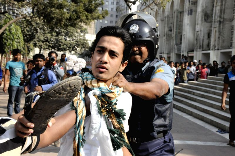 A protestor is arrested during a clash between police and protestors in Dhaka, Bangladesh, Jan. 15, 2015. Hundreds of Bangladeshi Muslims staged a protest - Abdul Latif Siddique