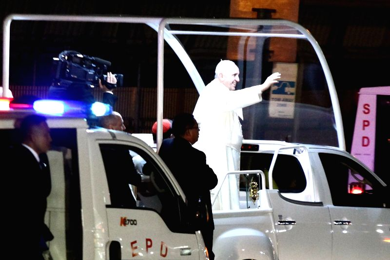 Pope Francis waves to the crowd during the first day of his papal visit in Pasay City, the Philippines, Jan. 15, 2015. Pope Francis is in the ...