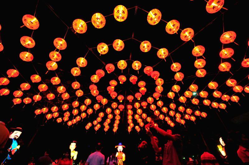People take photos of lanterns during Thailand Tourism Festival 2015 at Lumpini Park in Bangkok, Thailand, Jan. 15, 2015. Thailand Tourism Festival 2015