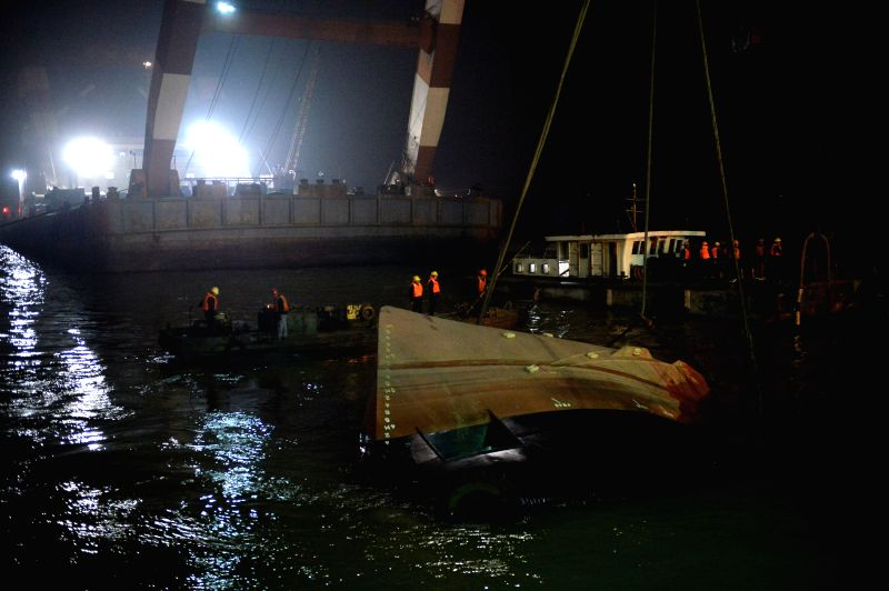 Rescuers salvage the wreck after a tug boat sank in the Yangtze River in east China's Jiangsu Province, Jan. 16, 2015. Rescuers have rescued three ...