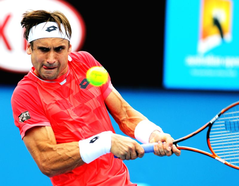 Spain's David Ferrer returns the ball during his men's singles first round match against Brazil's Thomaz Bellucci at the Australian Open tournament in