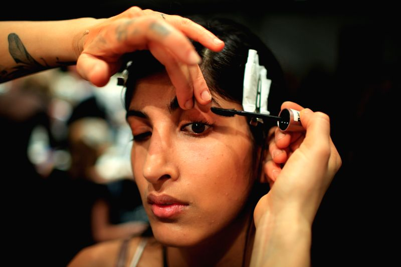 A model prepares for the show of German designer William Fan during the Mercedes-Benz Fashion Week Berlin Autumn/Winter 2015 in Berlin, Germany on Jan. ..