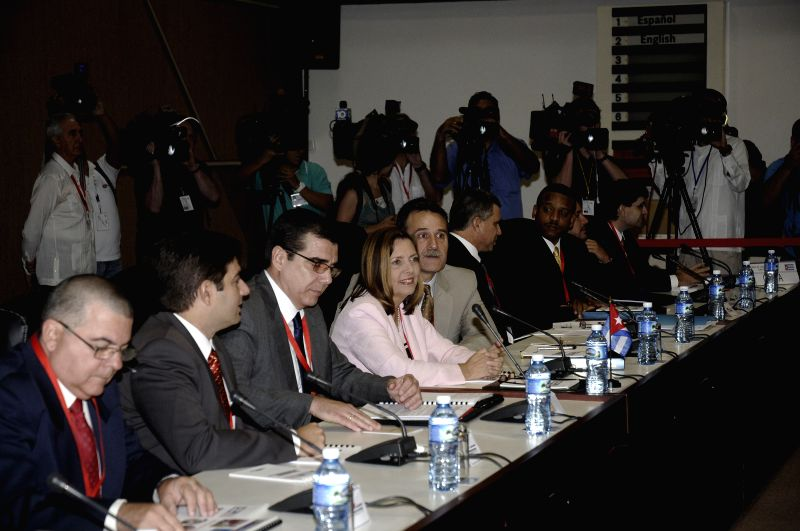Delegates of Cuba meet with delegates of the Unites States (not in the picture) at the Palace of Convention in Havana, Cuba, on Jan. 21, 2015. Cuba and ..