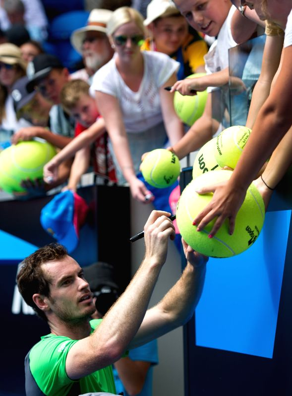 Andy Murray of Britain signs autographs for supporters after winning his men's singles second round match against Marinko Matosevic of Australia on ...