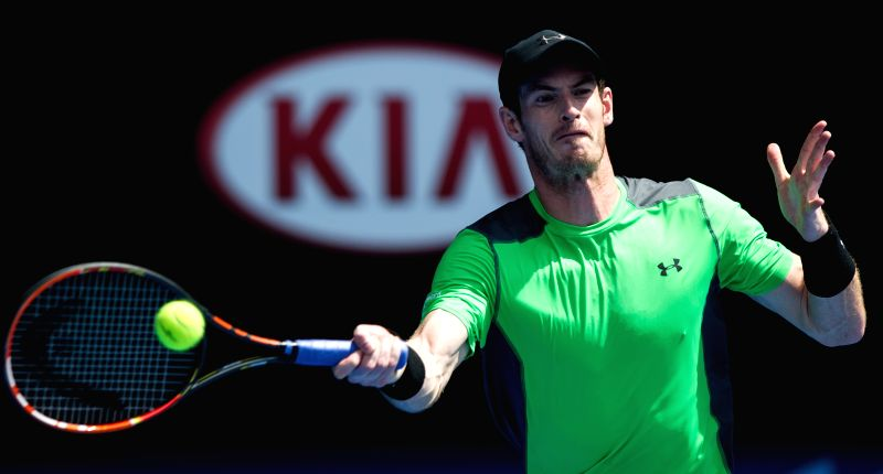 Andy Murray of Britain returns the ball during his men's singles second round match against Marinko Matosevic of Australia on the third day of the ...