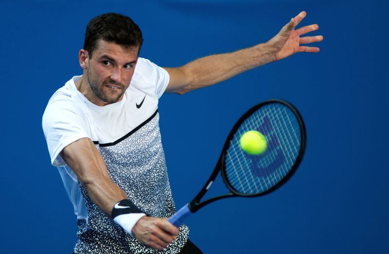 Grigor Dimitrov of Bulgaria hits a return to Lukas Lacko of Slovakia during their men's singles second round match at the Australian Open 2015 tennis .