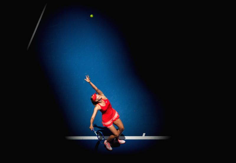Maria Sharapova of Russia serves the ball during her women's singles second round match against Alexandra Panova of Russia at the Australian Open ...