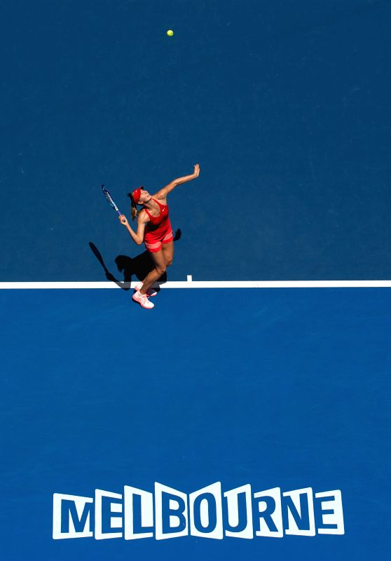 Maria Sharapova of Russia serves during her women's singles second round match against Alexandra Panova of Russia at the Australian Open tennis ...