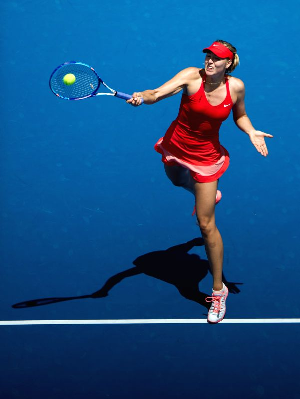 Maria Sharapova of Russia returns the ball during her women's singles second round match against Alexandra Panova of Russia at the Australian Open ...