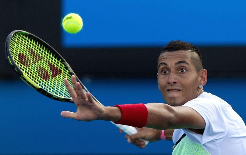 Nick Kyrgios of Australia returns the ball during his men's singles second round match against Ivo Karlovic of Croatia on day three of 2015 Australian