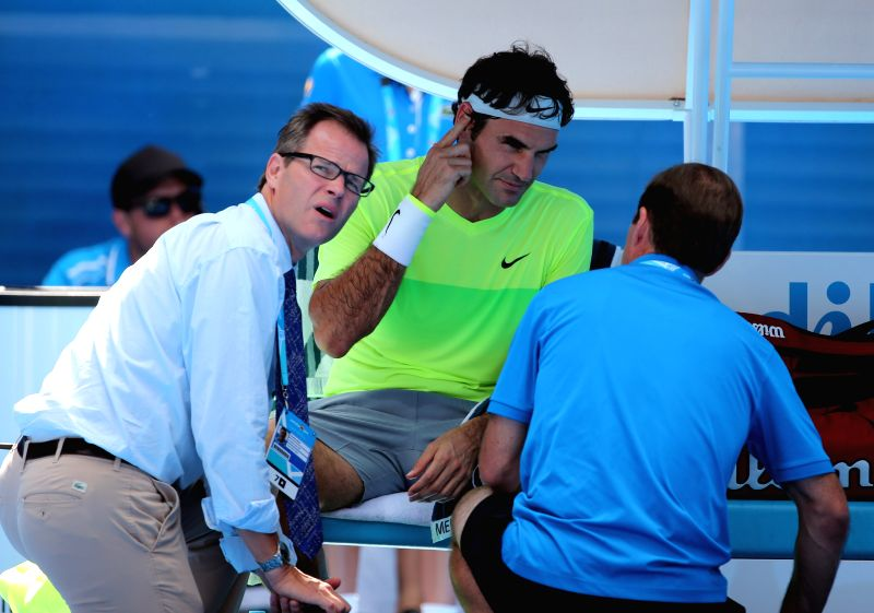 Roger Federer of Switzerland receives medical consultation during the second round match of men's singles against Simone Bolelli of Italy at the 2015 .