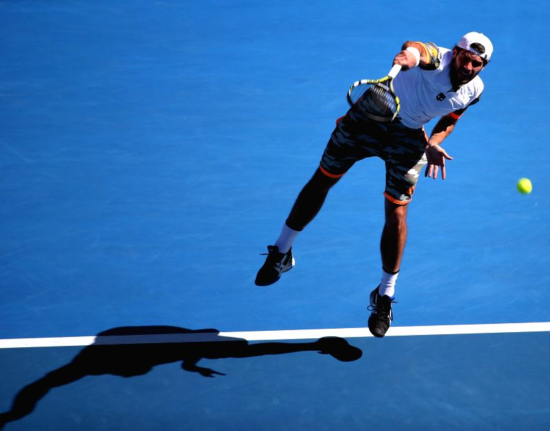 Simone Bolelli of Italy serves the ball during the second round match of men's singles against Roger Federer of Switzerland at the 2015 Australian ...