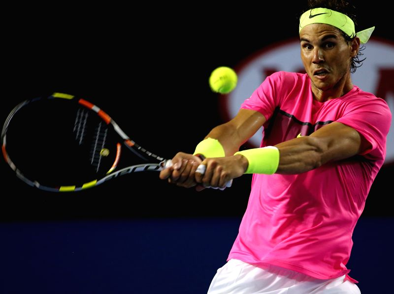 Spain's Rafael Nadal returns the ball during his men's singles second round match against Tim Smyczek of the US on the third day of the 2015 ...