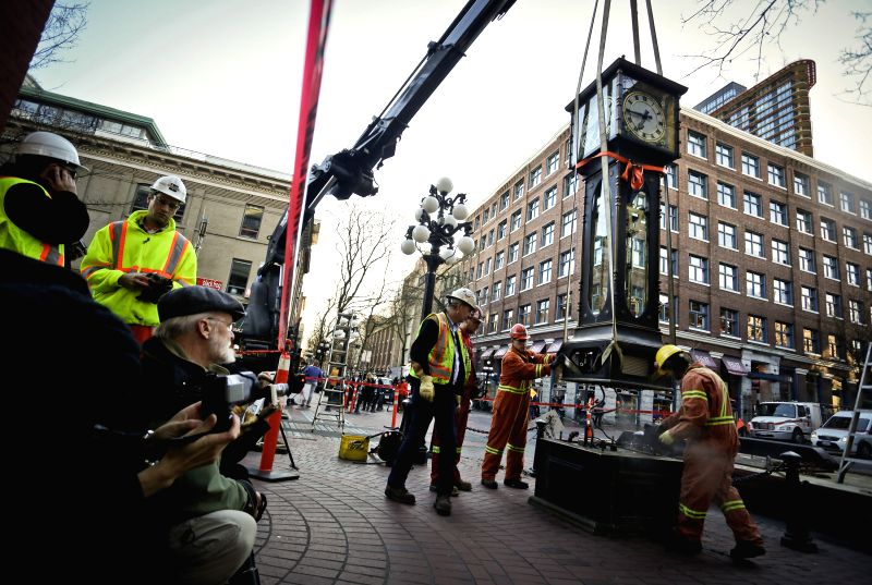 VANCOUVER (CANADA), Jan. 21, 2015 Workers re-install the steam clock to its original position at Gastown in Vancouver, Canada, Jan. 20, 2015. After a three-month absence from .