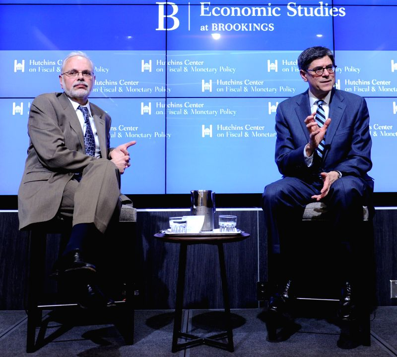 U.S. Treasury Secretary Jacob J. Lew (R) delivers remarks on the state of the U.S. economy and the administration's priorities for 2015, with a