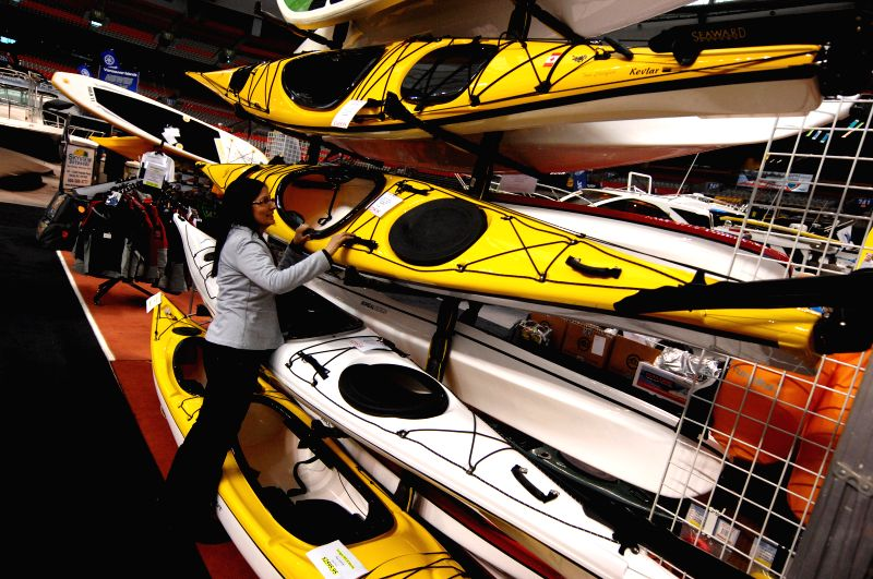 A visitor looks at kayaks at the 2015 Vancouver International Boat Show at BC Place in Vancouver, Canada, Jan. 21, 2015. Canada's premier 5-day ...