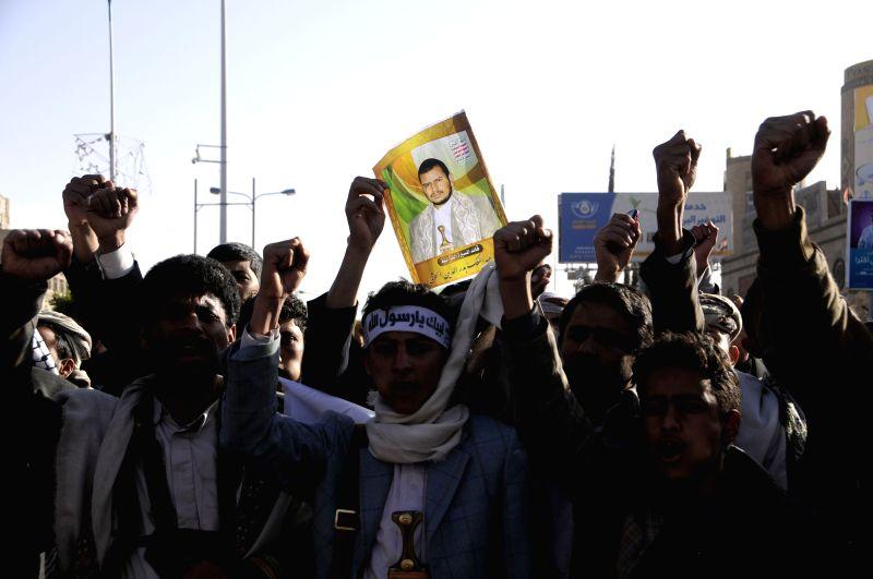 Followers of the Shiite Houthi group shout slogans during a demonstration in Sanaa, Yemen, on Jan. 23, 2015. Yemeni President Abd-Rabbu Mansour Hadi on ...