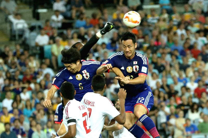 Japan's Maya Yoshida (R) heads for the ball during the quarterfinal match against United Arab Emirates at the 2015 AFC Asian Cup in Sydney, Australia, ...