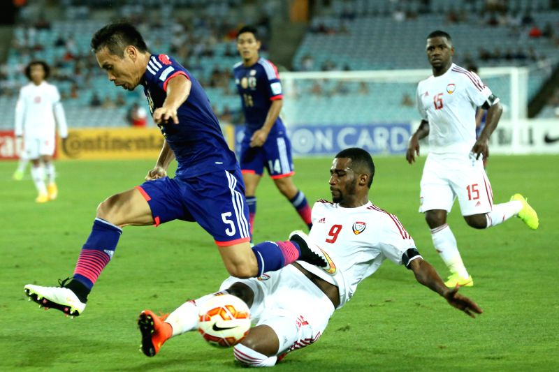 Japan's Yuto Nagatomo (L) fights with Abdulaziz Hussain Haikal of United Arab Emirates during the quarterfinal match at the 2015 AFC Asian Cup in Sydney, .
