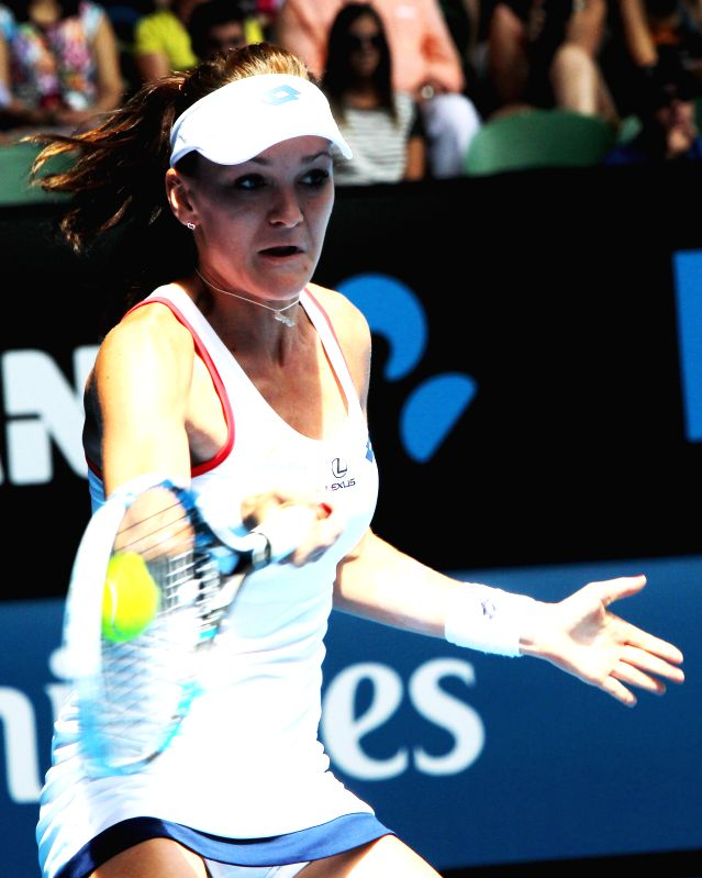 Agnieszka Radwanska of Poland returns the ball against Varvara Lepchenko of the United States during the third round of the women's singles on Day 6