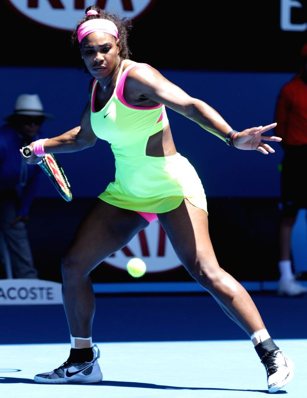 Serena Williams of the United States returns the ball during her women's singles third round match against Elina Svitolina of Ukraine at 2015 ...