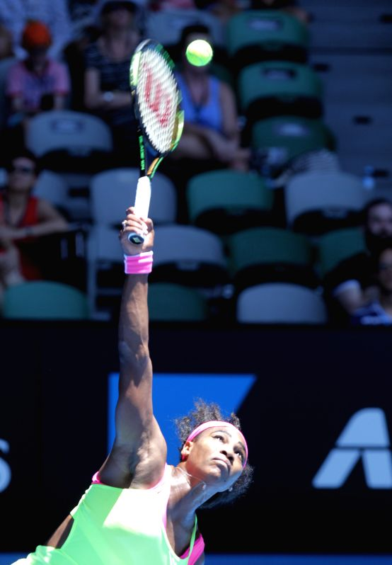 Serena Williams of the United States serves the ball during her women's singles third round match against Elina Svitolina of Ukraine at 2015 ...