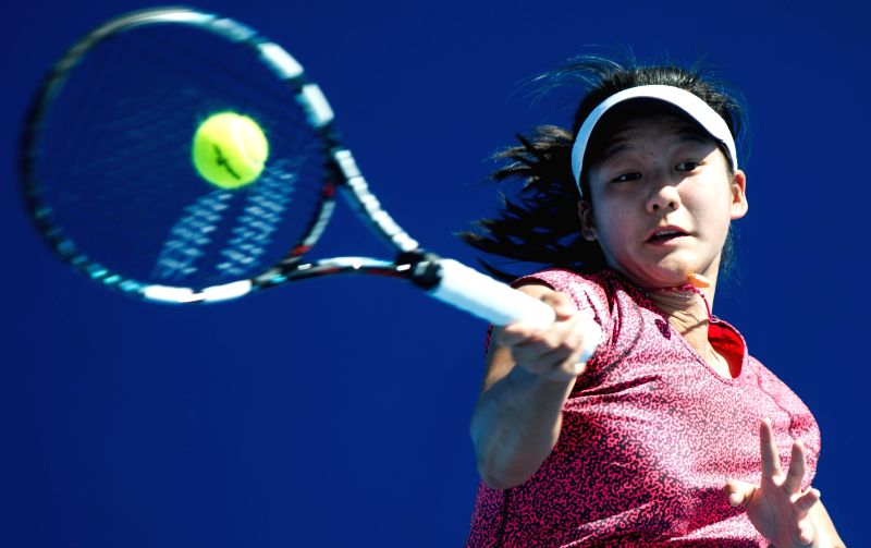 Zheng Wushuang of China returns the ball during her Junior Girls' Singles first round match against Michaela Haet of Australia at the 2015 Australian .