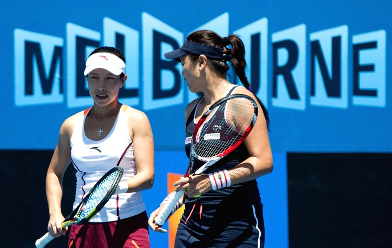 Zheng Jie (L) of China and Yung-Jan Chan of Chinese Taipei compete during their women's doubles second round match against Lara Arruabarrena of Spain .