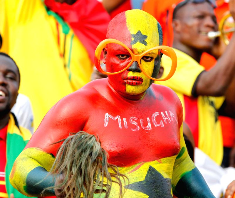 Football fans of Ghana pose for a photo before the group match of Africa Cup of Nations between Ghana and Algeria in Mongomo, Equatorial Guinea, Jan. ...