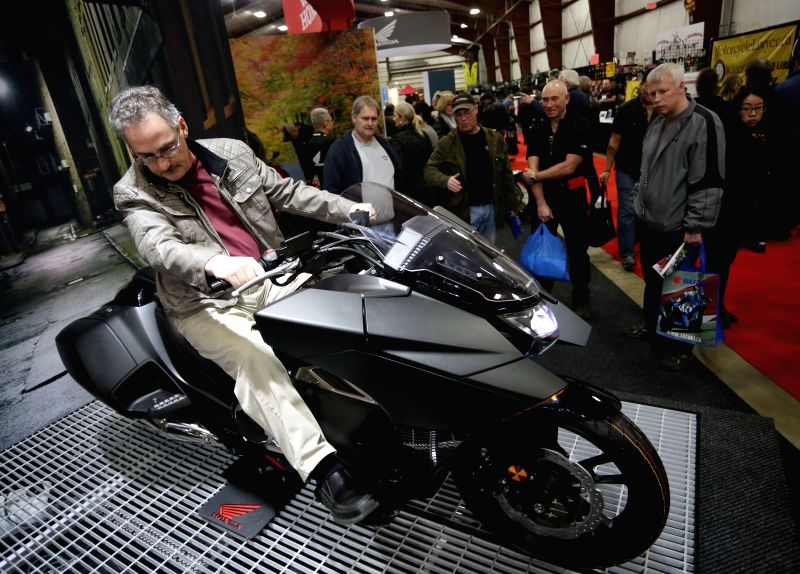 A visitor checks out a motorcycle displayed at the Vancouver International Motorcycle Show at Tradex center in Abbotsford, Canada, Jan. 23, 2015. Over