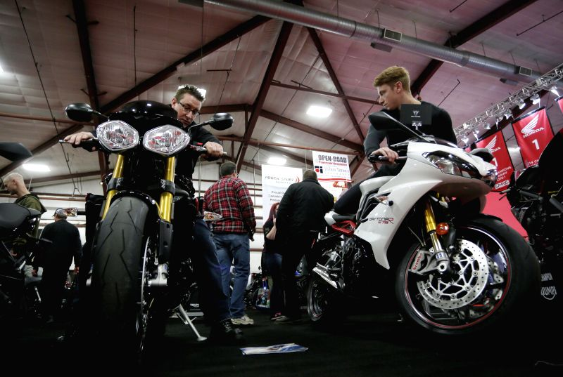 Visitors check out the new motorcycles displayed at the Vancouver International Motorcycle Show at Tradex center in Abbotsford, Canada, Jan. 23, 2015.