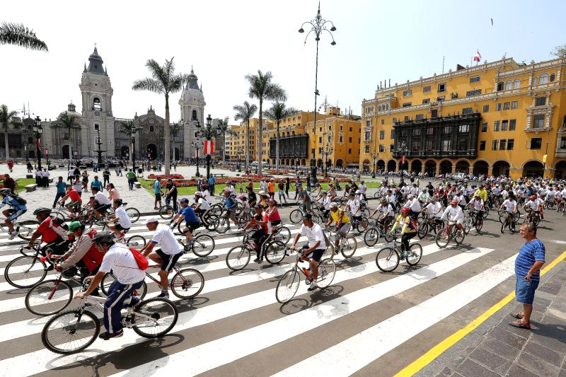Residents take part in a bike ride to commemorate the 480th anniversary of the founding of Lima, in Lima, Peru, on Jan. 25, 2015. (Xinhua/Norman ...