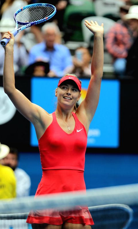 Maria Sharapova of Russia celebrates victory after her women's singles quarterfinal match against Eugenie Bouchard of Canada at Australian Open tennis
