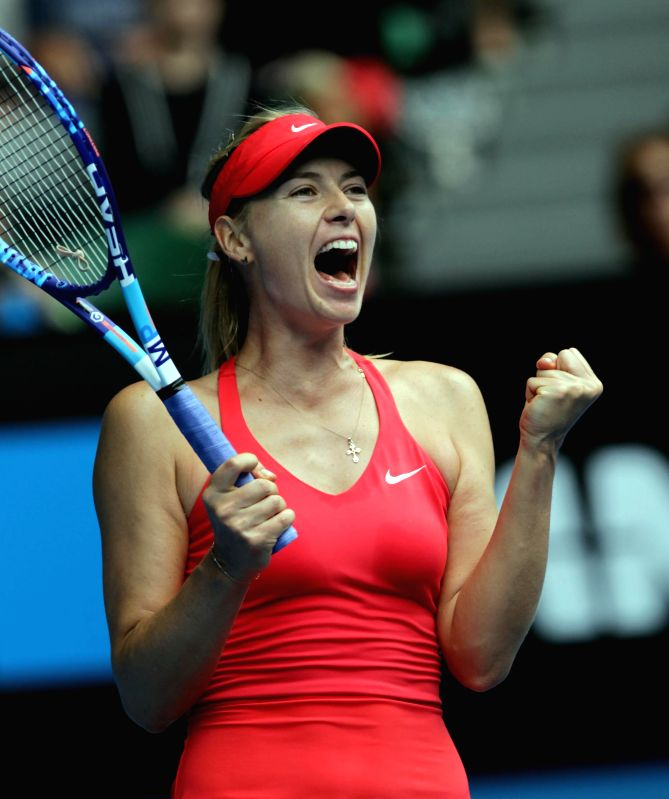Maria Sharapova of Russia celebrates victory after the women's single quarterfinal match against Eugenie Bouchard of Canada at Australian Open tennis .