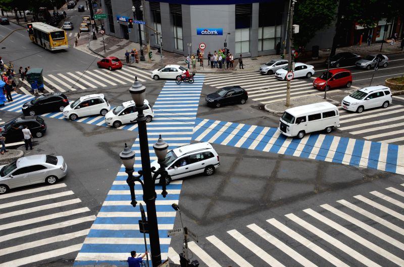 "Vehicles move over the pedestrian ""X"" crossing between Sao Joao and Ipiranga roads in downtown Sao Paulo, Brazil, Jan. 26, 2015. This type .."