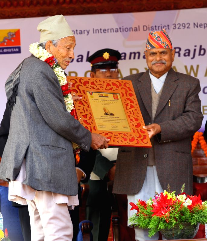 "Nepalese President Ram Baran Yadav (R) presents the Rotary Award titled ""Gopal-Kamala Rajbhandary Rotary Award for Vocational Excellence"" to . - Baran Yadav and Satya Mohan Joshi"