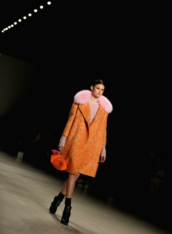 A model presents a creation of RANFAN by Chinese designer Ran Fan during the New York Fashion Week in New York, the United States, on Feb. 15, 2015. ...