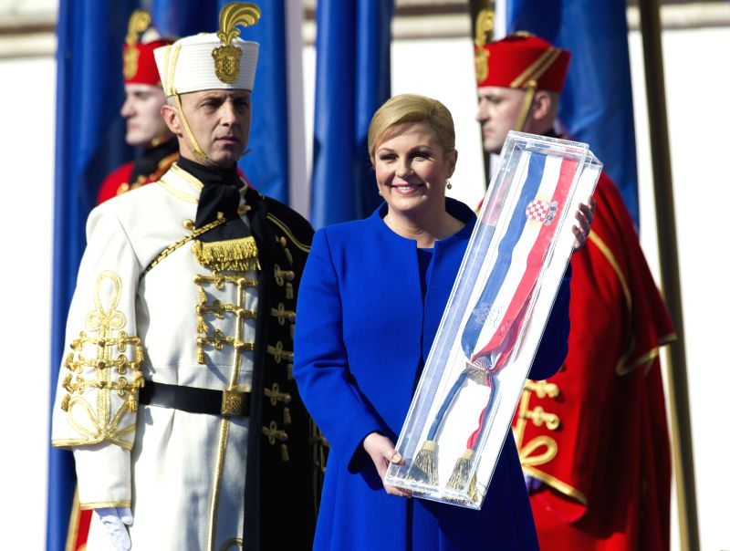 Kolinda Grabar-Kitarovic poses with the presidential sash after taking the oath of office as the President of Croatia during an official inauguration ...