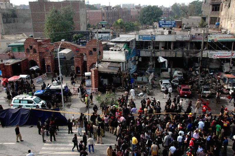 People gather at the suicide attack site in eastern Pakistan's Lahore, Feb. 17, 2015. At least eight persons were killed and 12 others injured on Tuesday