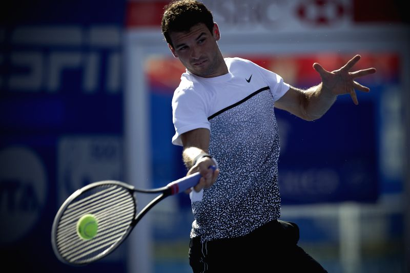 Bulgaria's Grigor Dimitrov, returns the ball to Serbia's Filip Krajinovic, during the men's single match of the Mexican Tennis Open 2015, in Acapulco, ...
