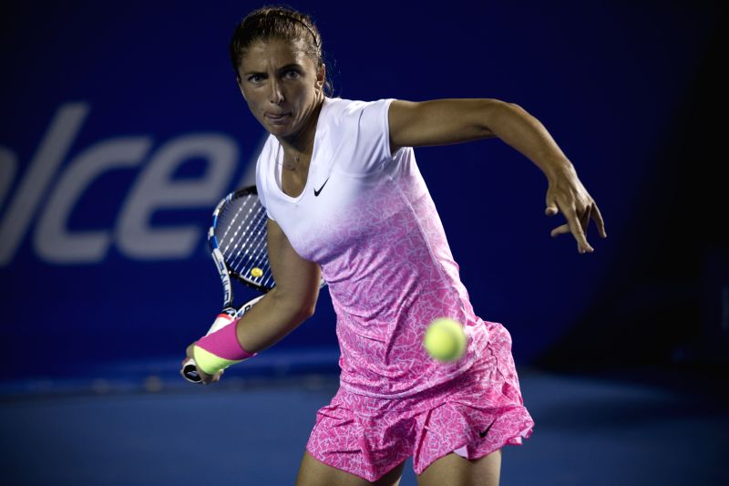 Italy's Sara Errani returns the ball to the Czech Republic's Lucie Hradecka during the women's single match of the Mexican Tennis Open 2015 in ...
