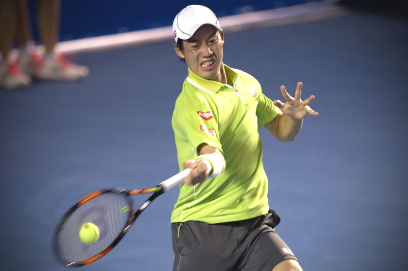 Kei Nishikori of Japan returns the ball after the men's single match against Lu Yen Hsun of Chinese Taipei at the Abierto Mexicano Telcel tennis ...