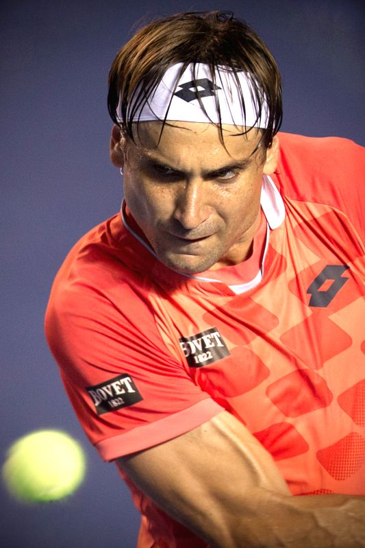 Spain's David Ferrer returns the ball during the men's single match against Australia's Marinko Matosevic at the Abierto Mexicano Telcel tennis ...
